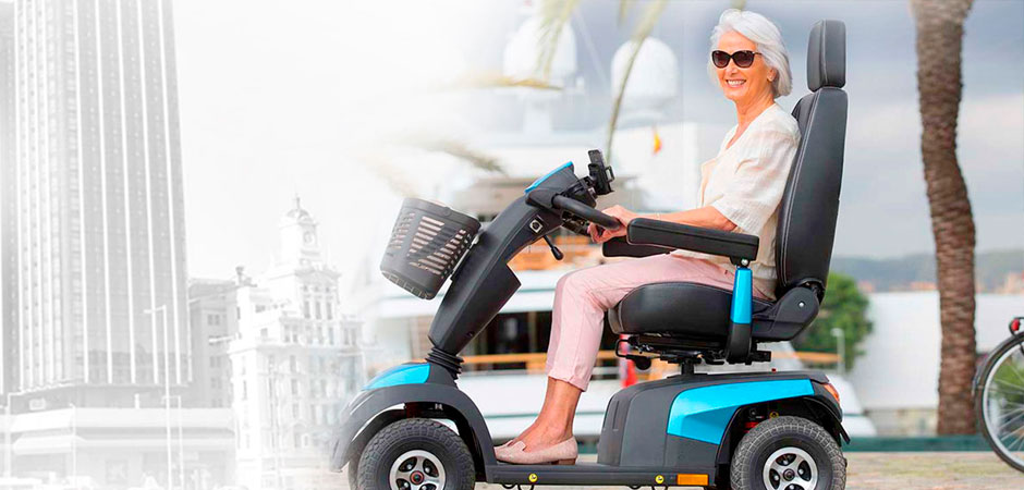 A woman is sitting on a mobility scooter
